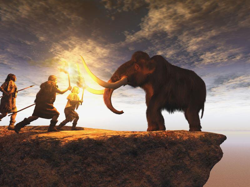 Animação retratando homens pré-históricos caçando um mamute.