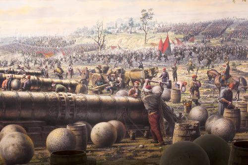 Canhões otomanos atirando contra a muralha de Constantinopla *